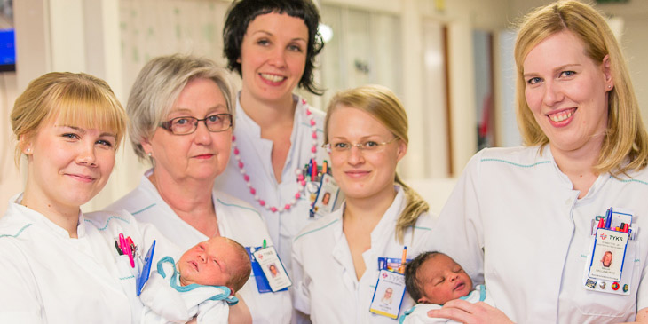 Nurses and two newborn babies.