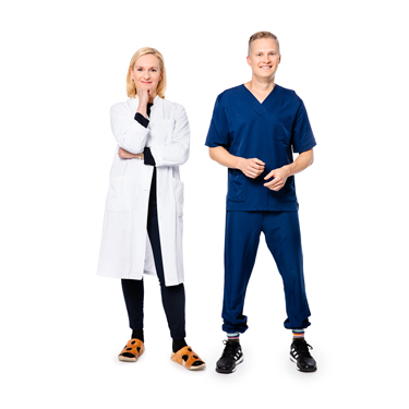 Doctor and nurse standing and smiling