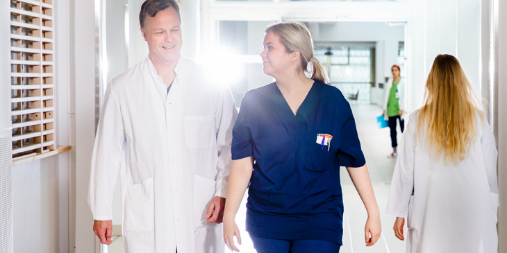 Doctor and nurse walking in a hallway